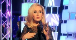 Adele waxwork in black dress