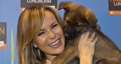 Amanda Holden holding a dog
