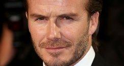 David Beckham wears a red ribbon