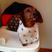 Image 7: A dog wearing a bib