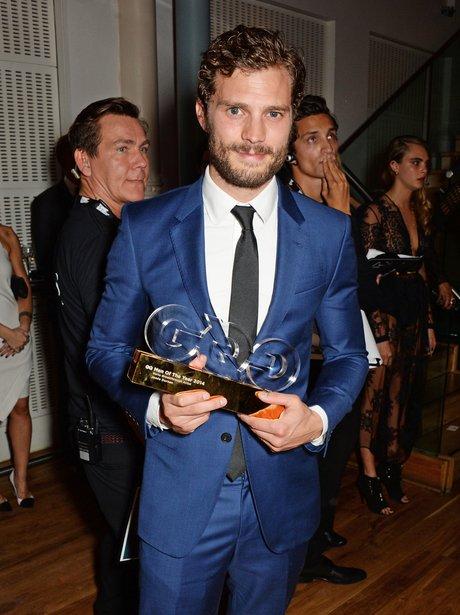 Jamie Dornan with his award at GQ Awards 2014