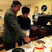 Newlyweds Stephen Fry and his husband Elliott Spencer cut cake.