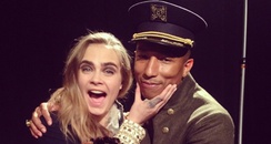 Cara Delevingne and Pharrell Williams at Chanel's