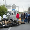 Protesting workers burn tyres
