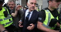 Fans swarm Charles Green as he leaves court