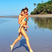 14. Gisele Bunchden and gives son Ben a piggy back along the beach.