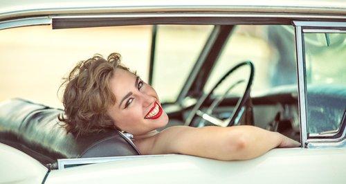 Woman driving vintage car
