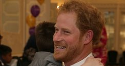 Prince Harry hugs kids at the awards