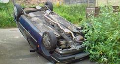 overturned car in Swindon